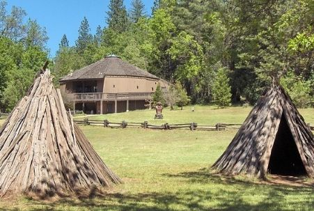 Miwok village with ceremonial hun'ge (roundhouse) at Indian Grinding Rock State Historic Park near Jackson, CA