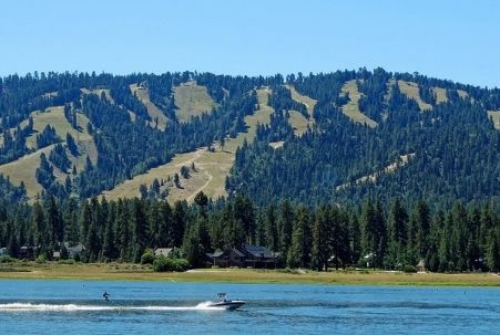 Summer water skier at Big Bear Lake and the mountain behind for winter snow skiing